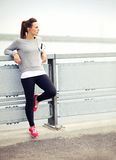 Female Jogger Resting Royalty Free Stock Photography