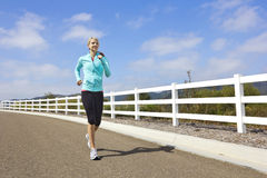 Female Jogger running outdoors Stock Images
