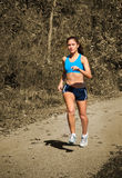 Female Jogger Running in Park Royalty Free Stock Images