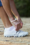 Female Jogger's Shoe Stock Image