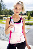 Female Jogger In Sportswear Holding Water Bottle On Stairway Royalty Free Stock Images