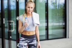 Female Jogger With Water Bottle And Napkin Outdoors Stock Photos