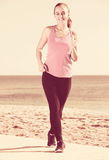 Female jogging at sea beach Royalty Free Stock Photos