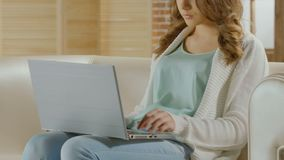 Female journalist typing article on laptop, freelancer working at home, closeup. Stock footage stock video footage