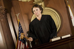Female Judge Forming A Judgment Royalty Free Stock Photos