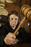 Female Judge Knocking Gavel Stock Image