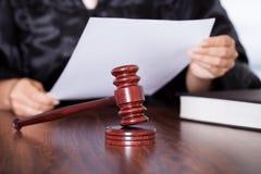 Female judge reading verdict Royalty Free Stock Photo
