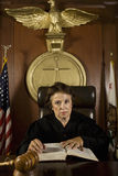 Female Judge Referring To Law Book Royalty Free Stock Images