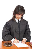 Female judge sign to blank court order Stock Images