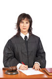 Female judge sign to blank court order Royalty Free Stock Images