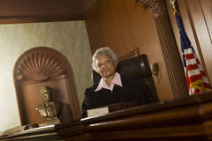Female Judge Sitting In Courtroom Royalty Free Stock Photo