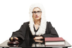 Female judge wearing a wig and Back mantle with eyeglasses with Royalty Free Stock Photo