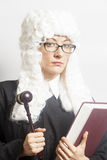 Female judge wearing a wig and Back mantle with eyeglasses Stock Images