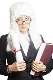 Female  judge wearing a wig with eyeglasses holding brief and bo Royalty Free Stock Image
