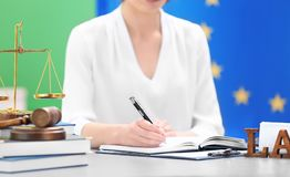 Female judge working with documents. And law accessories on table stock photography