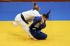 Female judo fighters Royalty Free Stock Images