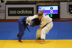 Female judo fighters. Ebony Drysdale-Daley (in blue) from France and Aleksandra Samardzic (in white) from Bosnia and Herzegovina fighting during European Judo royalty free stock image