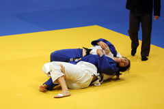 Female judo fighters - submission technique. Unknown female judo fighters pictured in action during the European Judo Championships for Individual Juniors held royalty free stock photo