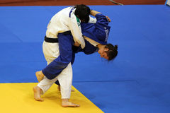 Female judo fighters. Unknown female judo fighters pictured in action during European Judo Championships for Individual Juniors held in Bucharest royalty free stock photos
