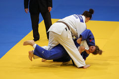Female judo fighters. Unknown female judo fighters pictured in action during the European Judo Championships for Individual Juniors held in Bucharest stock photos