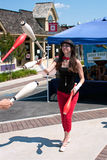 Female Juggler Performs At Summer Festival Royalty Free Stock Photography