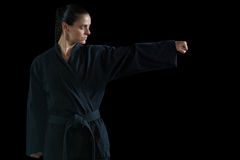 Female karate player performing karate stance Stock Photos