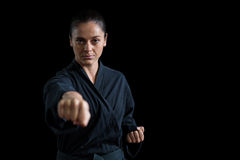 Female karate player performing karate stance Royalty Free Stock Photography
