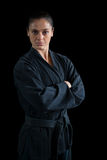 Female karate player standing with arms crossed Royalty Free Stock Image