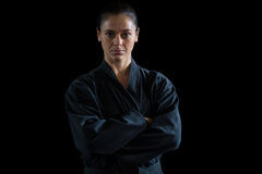 Female karate player standing with arms crossed Royalty Free Stock Photo