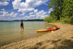 Female Kayaker. Wading to kayak Royalty Free Stock Image