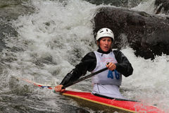 Female kayaker running whitewater rapids Royalty Free Stock Photography