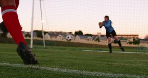 Female keeper waiting for female soccer player to kick the ball. 4k stock footage