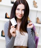 Female keeps credit card in footwear shop Royalty Free Stock Image