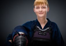 Female kendo fighter with men in the hand Stock Images