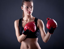Female kick  boxer with red gloves Stock Image