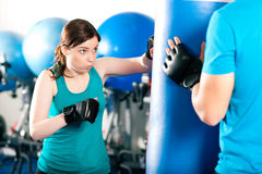 Female kick boxer with trainer in sparring Stock Photography