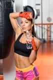 Female kickboxer drinks water Stock Image