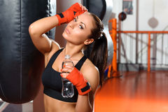 Female kickboxer drinks water Royalty Free Stock Photos