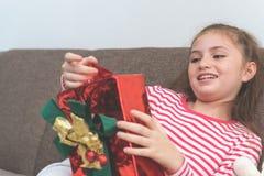 Female kid opening surprise present Christmas box Royalty Free Stock Photos