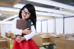 Female kid standing in the class Royalty Free Stock Image