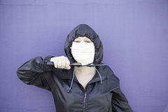 Female killer. Aggressive hooded woman, violence and lifestyle Royalty Free Stock Image