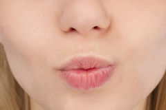 Female kiss lips. Close up Royalty Free Stock Photos