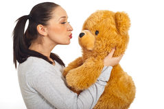 Female kissing teddy bear Royalty Free Stock Image