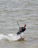 Female kite surfer. Photo of a female kite surfer on the coast of whitstable in kent england.photo taken 17th june 2014 and ideal for active outdoor sports,kite Stock Photography