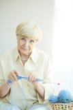 Female knitting Stock Images