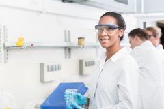 Female lab technician with safety goggles. In laboratory Stock Photography