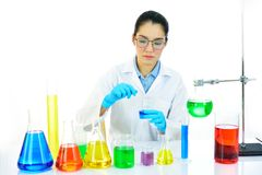 Female lab technician working in medical laboratory. Asian female medical technologist working with chemical in research laboratory Royalty Free Stock Photography