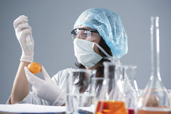 Female Laboratory Assistant in Facial Mask And Protective Gloves Making Injection Stock Photos