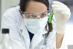 Female Laboratory Scientist Doctor Green Test Tube Stock Photos