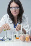 Female Laboratory Staff Dealing with Color Chemicals in Lab Royalty Free Stock Photos